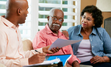 Financial Advisor Talking To Senior Couple about estate planning